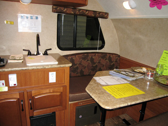 The Convertible Dinette And Kitchen Sink (stove Is To The Left Out Of View,  Cabinets Above And Below). The Unit Also Had AC And A Furnace.