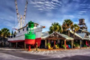 The former Flounder's Shrimp Boat welcomes visitors to the restaurant.