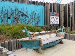 Relax on this funky bench outside the entrance to Red Fish Blue Fish
